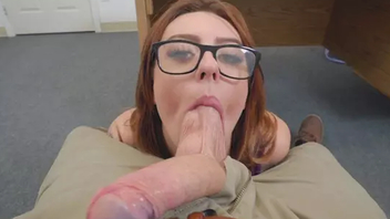 Secretary with red hair and glasses cajoles the boss with oral sex